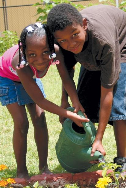 Children watering the garden